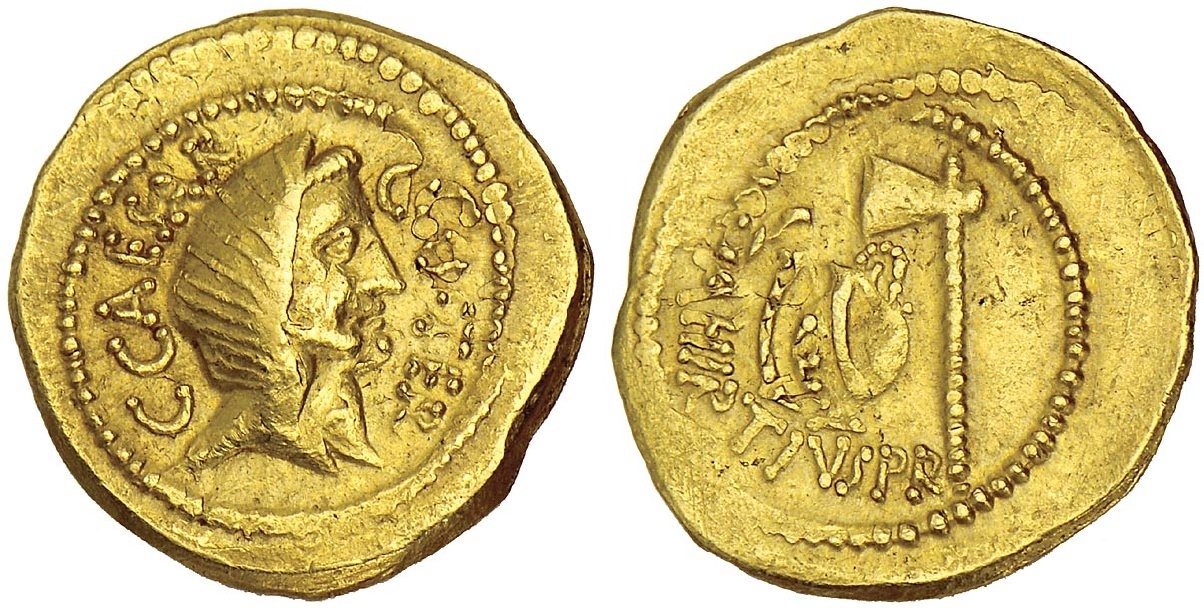 This gold coin reveals the veiled head of julius caesar on the front